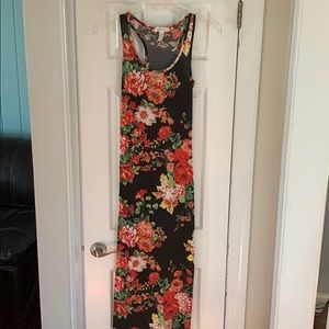 Black maxi dress with floral pattern.